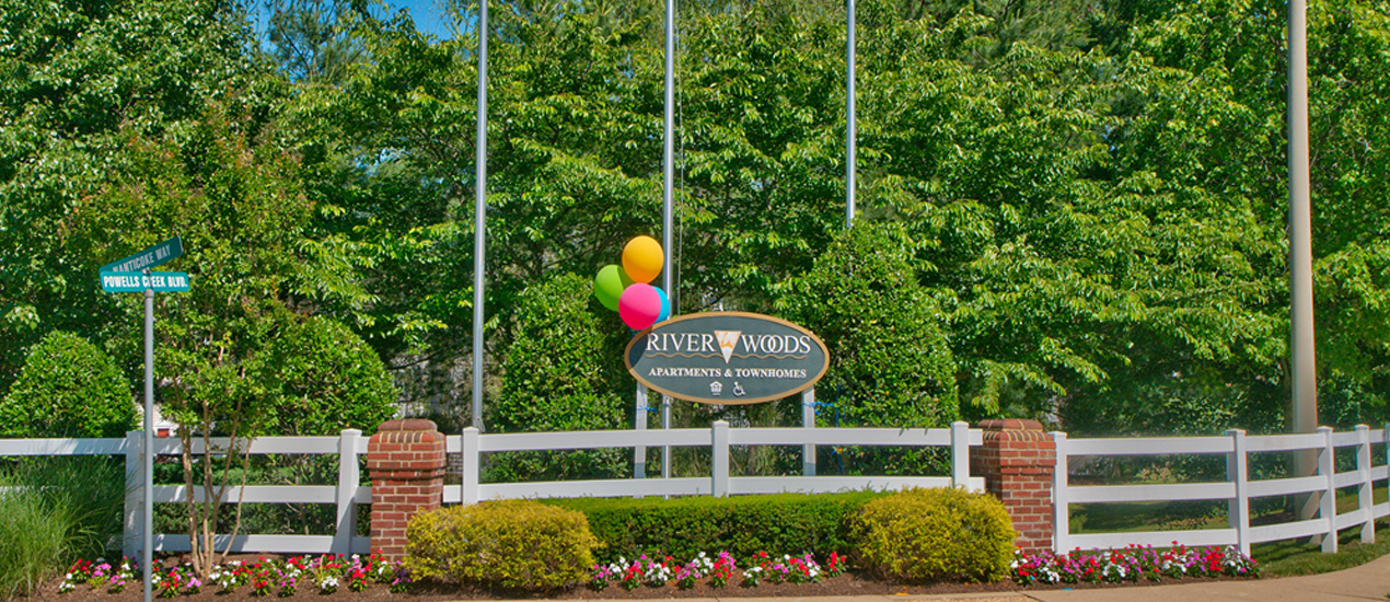 Riverwoods Apartments and Townhomes Sign