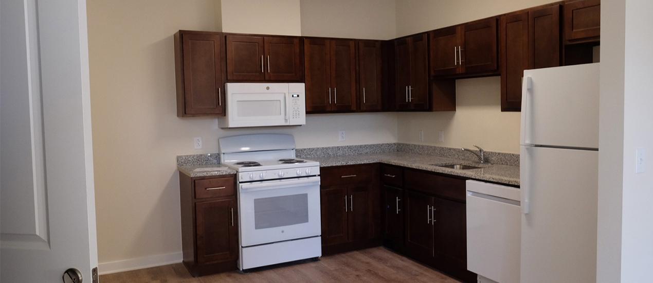 Kitchen with Dark Cabinets and Modern Appliances