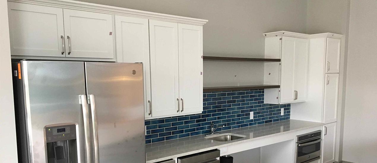 Interior kitchen with fridge and tile back splash