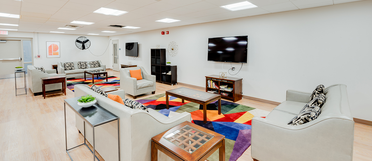 Community room with tv and seating areas